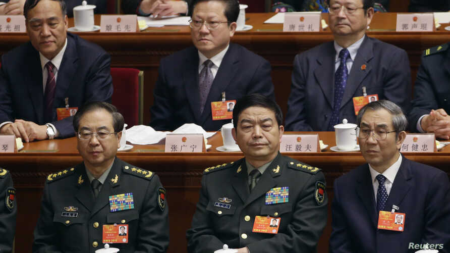 China's newly-elected Defense Minister Chang Wanquan (front row, C) sits together with other delegates as he attends the sixth plenary meeting of the National People's Congress (NPC) at the Great Hall of the People in Beijing, March 16, 2013.