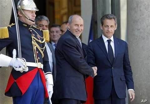 France's President Nicolas Sarkozy, right, with Libyan National Transitional Council's Mustafa Abdel Jalil after a meeting at the Elysee Palace, Paris, April 20, 2011