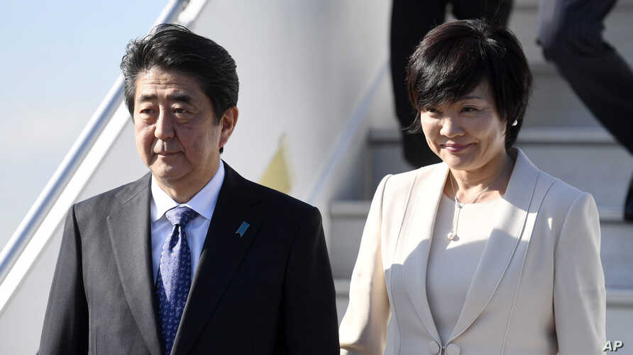 Japanese Prime Minister Shinzo Abe and his wife, Akie, arrive at the Helsinki International Airport in Vantaa, Finland, July 9, 2017, the second leg of Abe's Nordic tour. Abe's approval ranking has fallen at home.