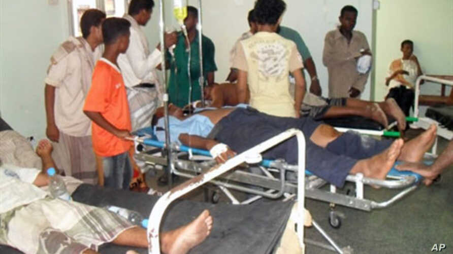 Injured Yemenis lie on stretchers at a hospital in the southern town of Zinjibar after suspected al-Qaeda gunmen launched simultaneous attacks on the intelligence and security services headquarters, 14 Jul 2010