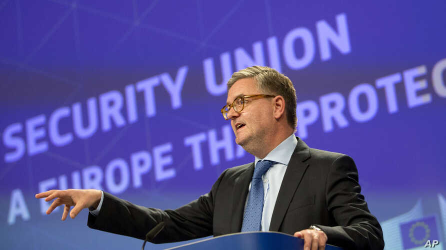 European Commissioner for Security Julian King speaks during a media conference at EU headquarters in Brussels on Oct. 18, 2017.