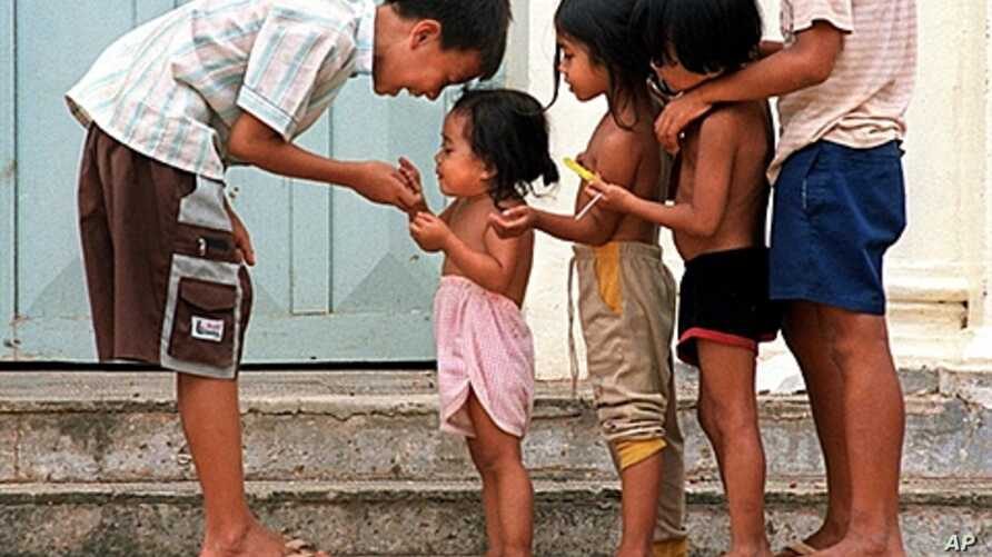 Cambodian orphans play together as they wait for adoption at Kien Klaing orphanage center in Phnom Penh, (File)
