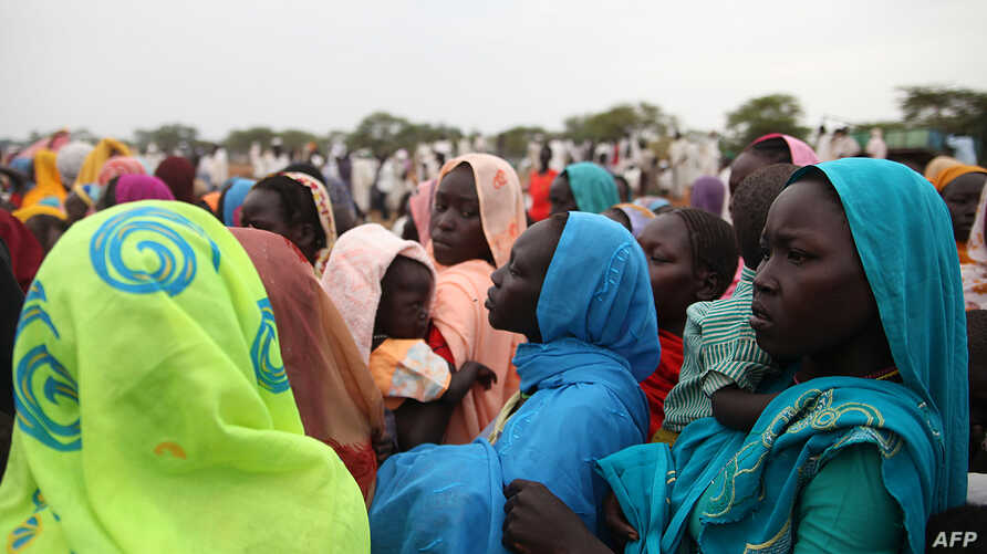 This photo taken on June 15, 2012, at the Jamam refugee camp, shows mothers queueing at a Medecin Sans Frontiere (MSF) field hospital in South Sudan's Upper Nile state, where over 100,000 refugees have fled conflict in Sudan's Blue Nile state since S