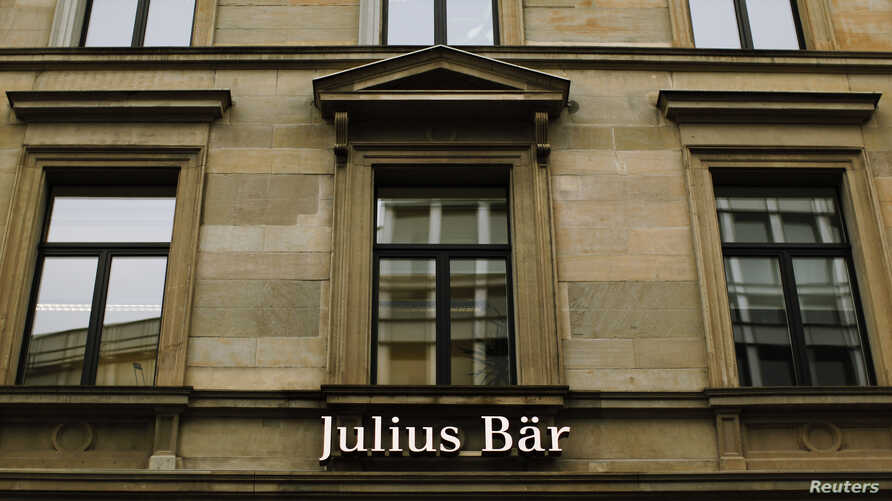 Swiss private bank Julius Baer, reported a slump in profits, is being investigated by U.S. authorities cracking down on tax evasion, February 4, 2013.