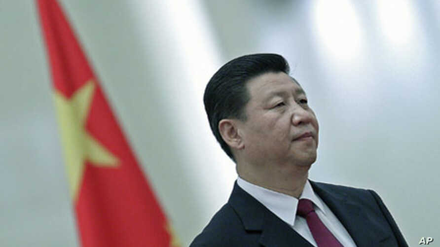 Chinese Vice President Xi Jinping listens to national anthems during a welcoming ceremony for South Africa's Vice President Kgalema Motlanthe inside the Great Hall of the People in Beijing, China, September 2011. (file photo)