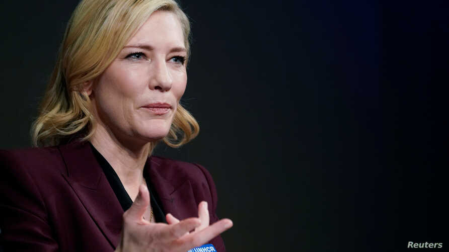 FILE - Actress Cate Blanchett, goodwill ambassador for the United Nations High Commissioner for Refugees (UNHCR), gestures as she attends the World Economic Forum (WEF) annual meeting in Davos, Switzerland, Jan. 23, 2018.