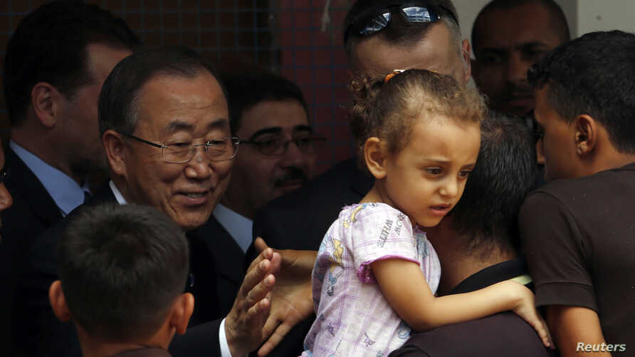 United Nations chief Ban Ki-moon greets a Palestinian man, whose house was destroyed, at a UN-run school for refugees in Gaza City on Oct. 14, 2014.