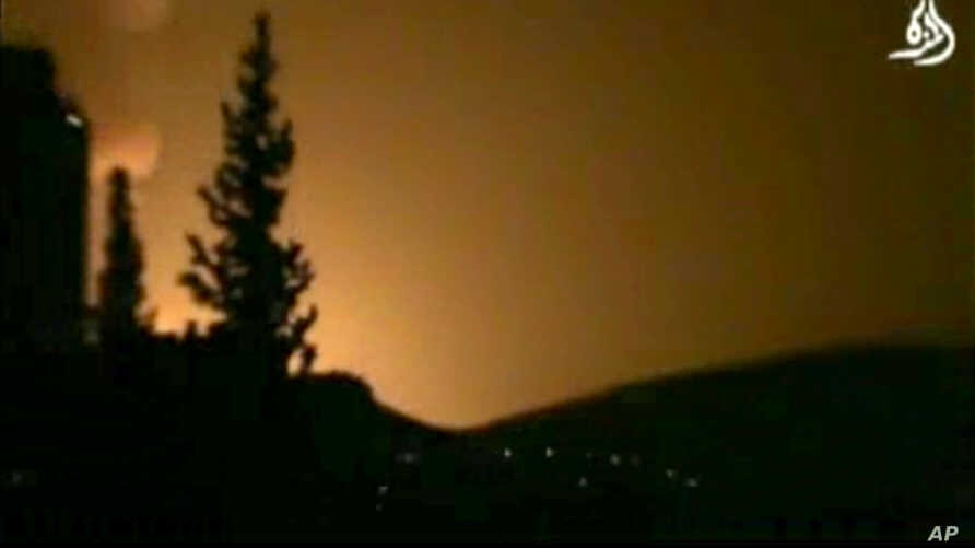 In this image taken from video obtained from Shaam News Network, which has been authenticated based on its contents and other AP reporting, smoke and fire fill the skyline over Damascus, Syria, early Sunday, May 5, 2013 after an Israeli airstrike.