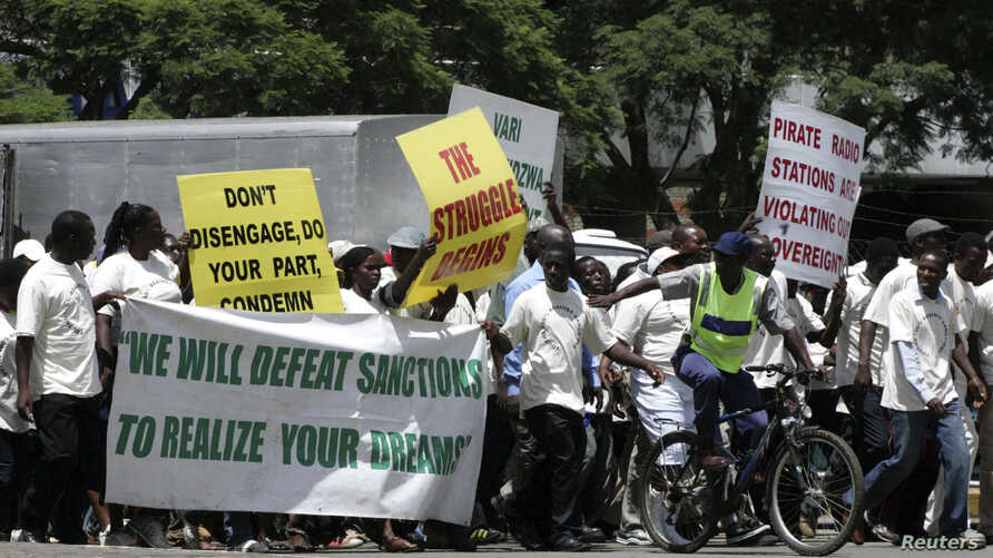 FILE - Supporters of the Zimbabwe African National Union's Patriotic Front (ZANU-PF) march in Harare, Feb. 24, 2010, to protest against a European Union decision to extend economic sanctions on Zimbabwe.