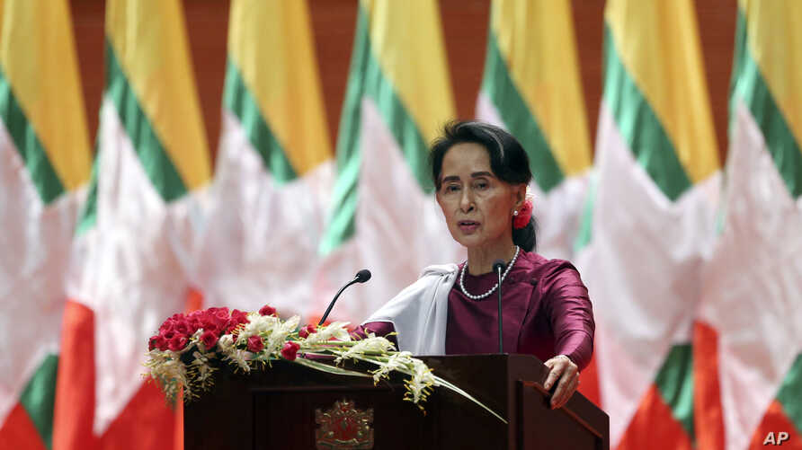 Myanmar's State Counsellor and de facto leader Aung San Suu Kyi delivers a televised speech to the nation at the Myanmar International Convention Center in Naypyitaw, Myanmar, Sept. 19, 2017.