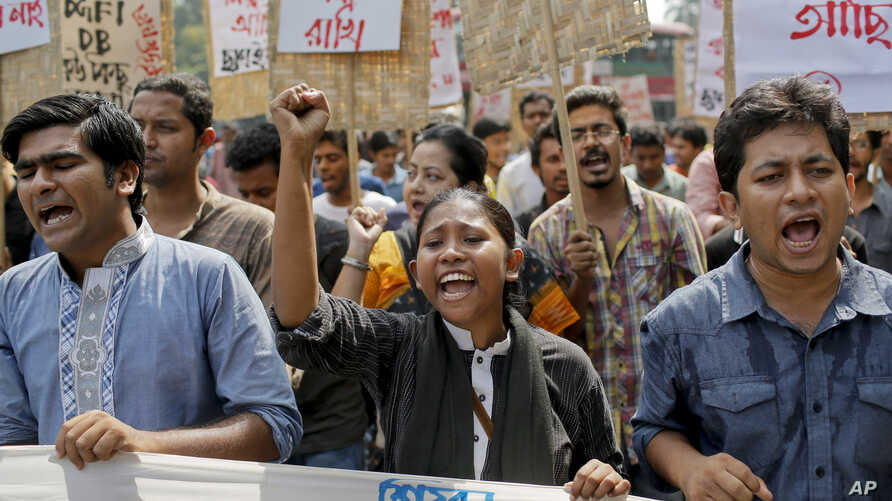 Bangladeshi youth shout slogans as they protest the killing of Faisal Arefin Deepan, a publisher of secular books, in Dhaka, Bangladesh, Nov. 1, 2015.