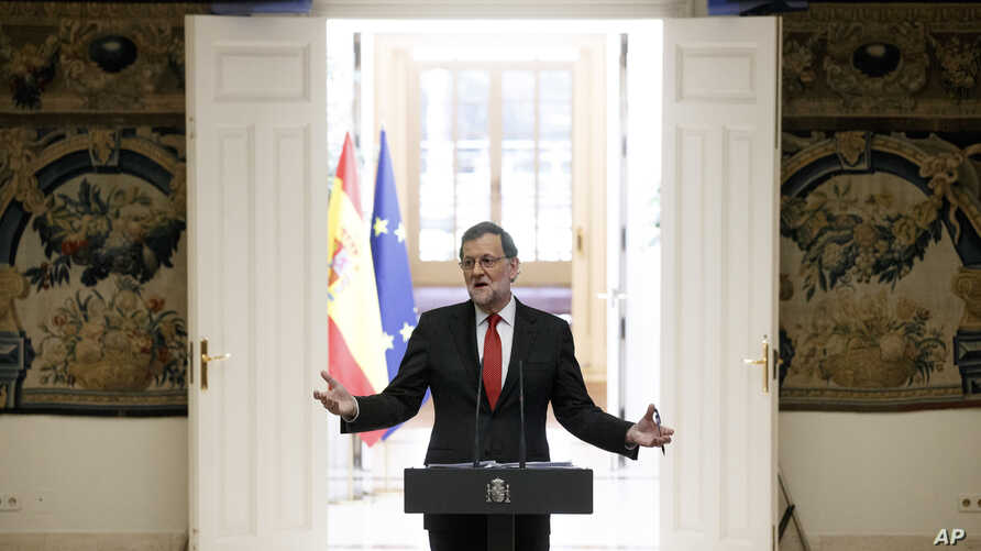 Spain's Prime Minister Mariano Rajoy gestures during a traditional press conference at the end of the year held at the Moncloa Palace in Madrid, Spain, Friday, Dec. 30, 2016 .