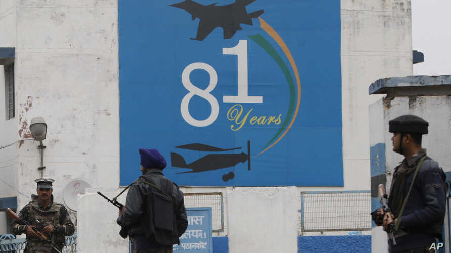 Indian soldiers stand guard outside an airbase in Pathankot, India, Jan. 4, 2016.