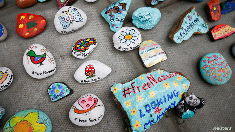 Stones with messages are placed on the pavement outside the Foreign and Commonwealth Office during a demonstration to demand the release of Nazanin Zaghari-Ratcliffe who is imprisoned in Iran, in London, March 10, 2018.