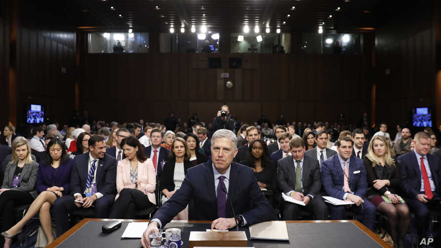 Supreme Court Justice nominee Neil Gorsuch takes his seat as he arrives on Capitol Hill in Washington, March 21, 2017, for his confirmation hearing before the Senate Judiciary Committee.