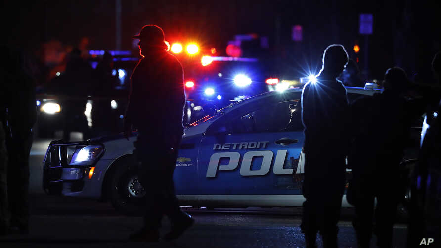 Police search the area where a Wayne State University police officer was shot while on duty near the campus Tuesday, Nov. 22, 2016, in Detroit. Five-year veteran Collin Rose, 29, died Wednesday, Nov. 23, 2016.