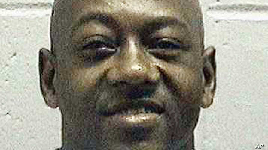 This undated photo made available by the Georgia Department of Corrections, shows Timothy Tyrone Foster. The Supreme Court has thrown out a death sentence handed to Foster because prosecutors improperly kept African-Americans off the jury that convic