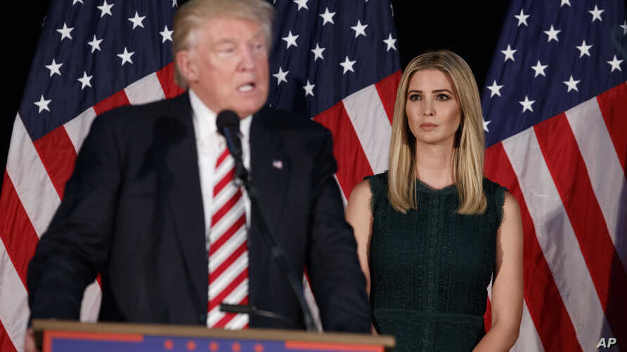 FILE - Ivanka Trump, right, looks on as her father, Donald Trump, delivers a policy speech on child care.