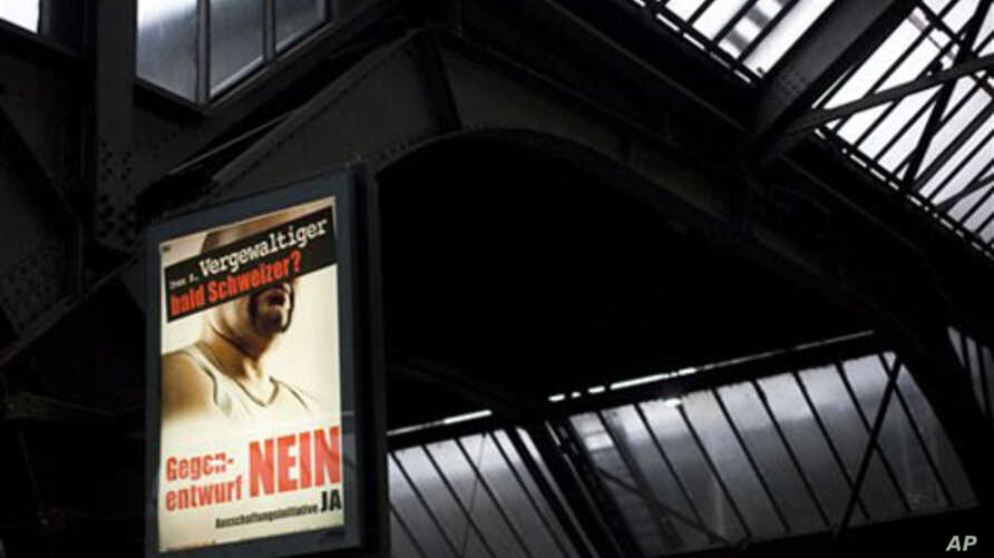 A campaign poster at a train station in Zurich reads 'Ivan S, rapist and soon to be Swiss?', 28 Nov 2010