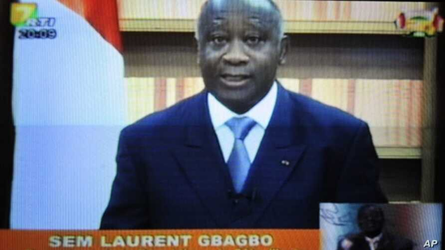 A picture of a TV screen shows Ivory Coast strongman Laurent Gbagbo delivering a speech in which he insists he remains the country's true president, 21 Dec 2010