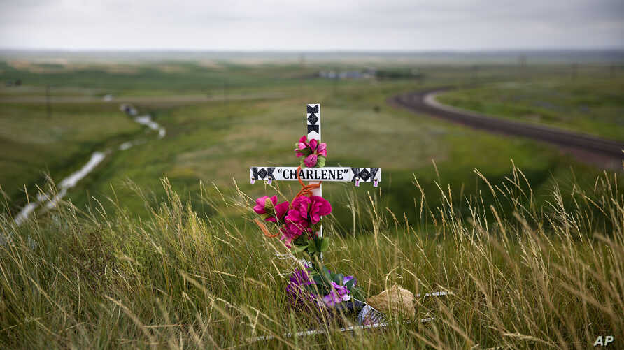 A makeshift memorial stands near the scene where Charlene Mancha was killed by her husband last year on the Blackfeet Indian Reservation in Browning, Mont., July 14, 2018. Thomas Edward Mancha pleaded guilty of second-degree murder in her death.