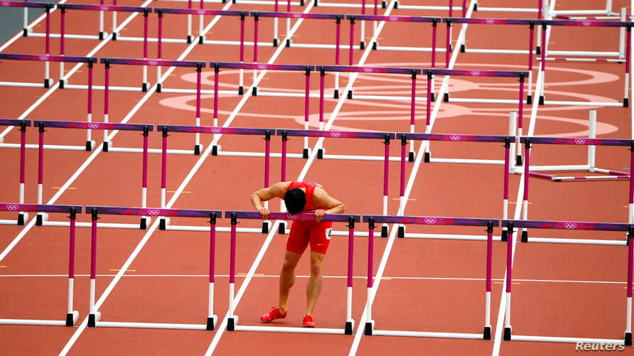 China's Liu Xiang kisses the last hurdle in his lane after his men's 110m hurdles round 1 heat.  Liu crashed out of the heats in the 110 metres hurdles on Tuesday in an echo of his injury-induced withdrawal from the same stage of the Beijing Games fo
