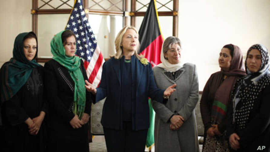 U.S. Secretary of State Hillary Rodham Clinton, center left, meets with Afghan women during a Civil Society roundtable discussion at the U.S. Embassy in Kabul, Afghanistan October 20, 2011.