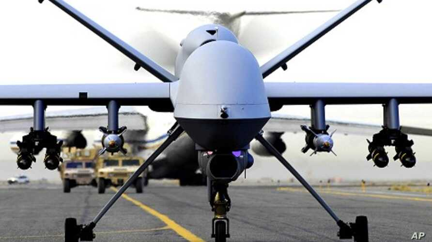 Fully armed MQ-9 Reaper unmanned aerial vehicle taxis down the runway (file photo)