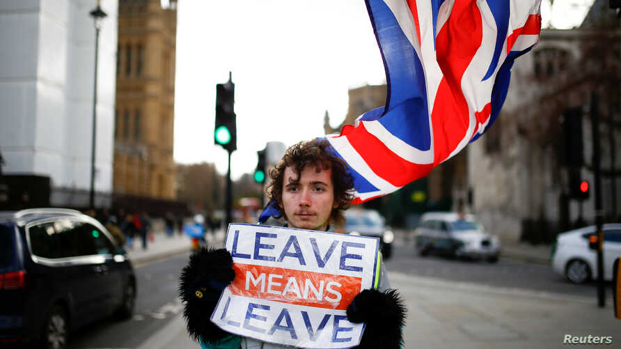 A pro-Brexit protester stands outside the Houses of Parliament in London, Britain, Feb. 7, 2019.