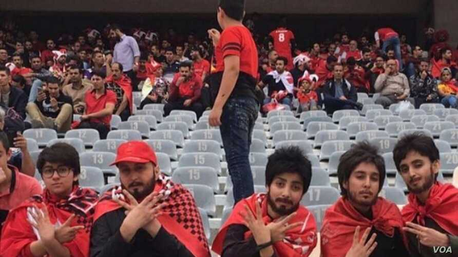Five young Iranian women who disguised themselves as men to enter Tehran's Azadi stadium watch their home team Persepolis in action against Sepidrood, April 27, 2018. (Photo: Khabar Online)