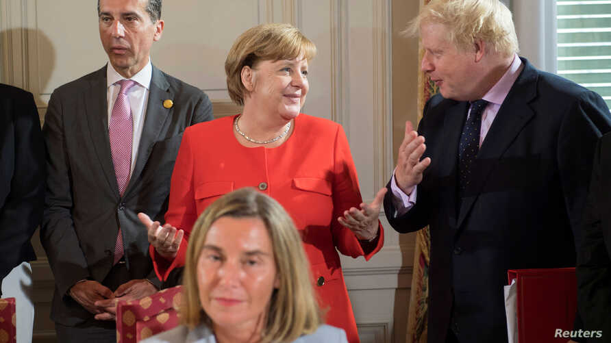German Chancellor Angela Merkel, Britain's Foreign Secretary Boris Johnson and Austria's Chancellor Christian Kern attend a summit of six Western Balkan countries in Triest, Italy July 12 2017.