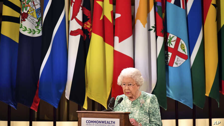 Britain's Queen Elizabeth II speaks during the formal opening of the Commonwealth Heads of Government Meeting in the ballroom at Buckingham Palace in London, April 19, 2018.
