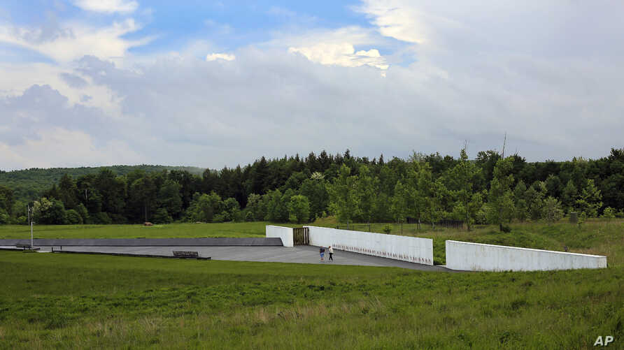 Visitors to the Flight 93 National Memorial visit the Wall of Names containing the names of the 40 passengers and crew of United Flight 93 that were killed in this field on Sept. 11, 2001, on May 31, 2018.