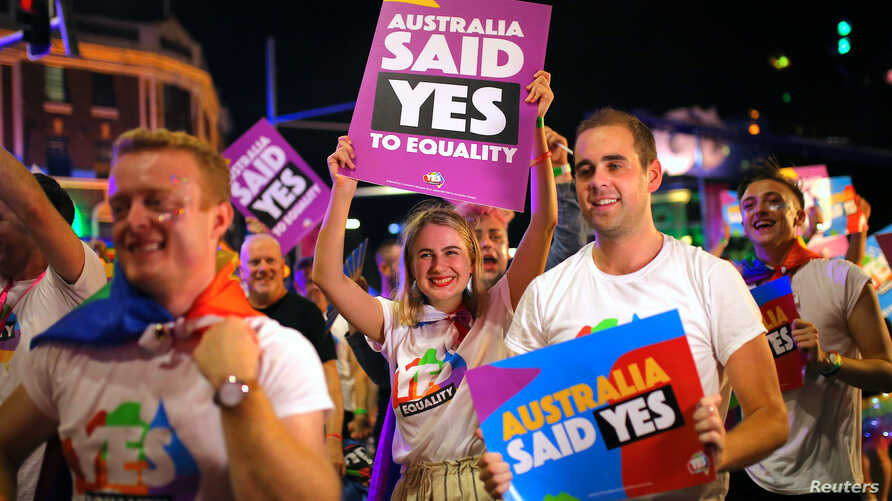 Participants hold banners regarding same-sex marriage during the 40th anniversary of the Sydney Gay and Lesbian Mardi Gras Parade in central Sydney, Australia, March 3, 2018.