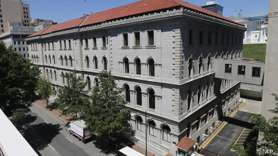 This May 2, 2017 photo shows the US 4th Circuit Court of Appeals building, the site of a full 15-member court hearing on President Donald Trump's revised travel ban targeting six Muslim-majority countries in Richmond, Va.