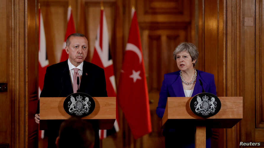 Turkey's President Recep Tayyip Erdogan and British Prime Minister Theresa May take part in a news conference after their meeting at 10 Downing Street in London, Britain, May 15, 2018.