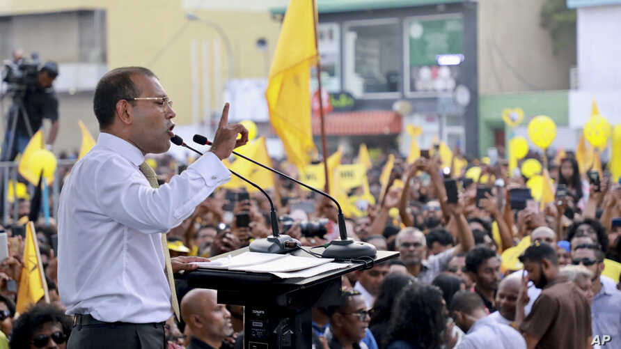 Maldives' former president Mohamed Nasheed, addresses the public in Male, Maldives, Thursday, Nov.1, 2018. Nasheed, the first democratically elected president of the Maldives returned home Thursday after more than two years in exile to escape a long