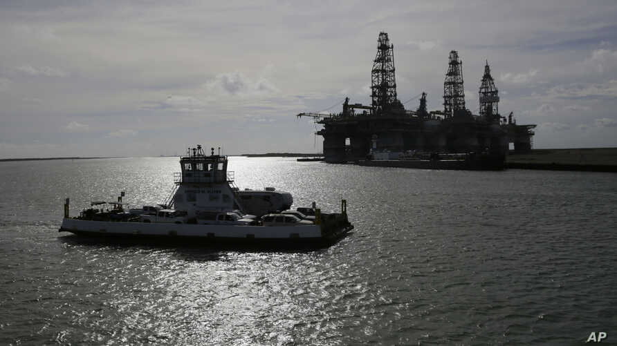 In preparation for Hurricane Harvey, Aug, 24, 2017, oil platforms were parked after a mandatory evacuation was ordered. With Tropical Storm Nate forecast to hit the Gulf Coast, similar plans are underway.