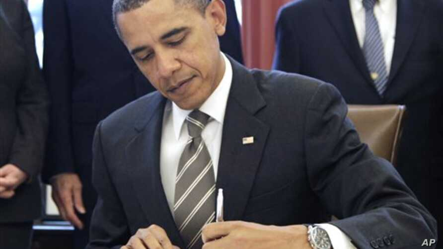 President Barack Obama signs the New START Treaty, in the Oval Office of the White House in Washington,  Feb 2, 2011