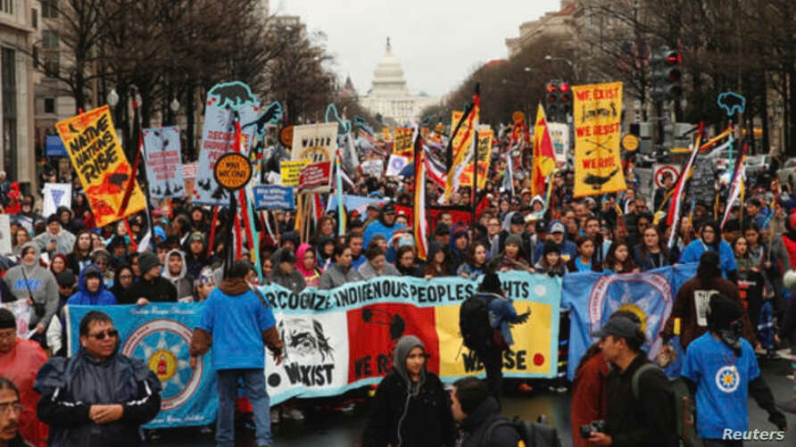 Indigenous leaders participate in a protest march and rally in opposition to the Dakota Access and Keystone XL pipelines on October 3, 2017.