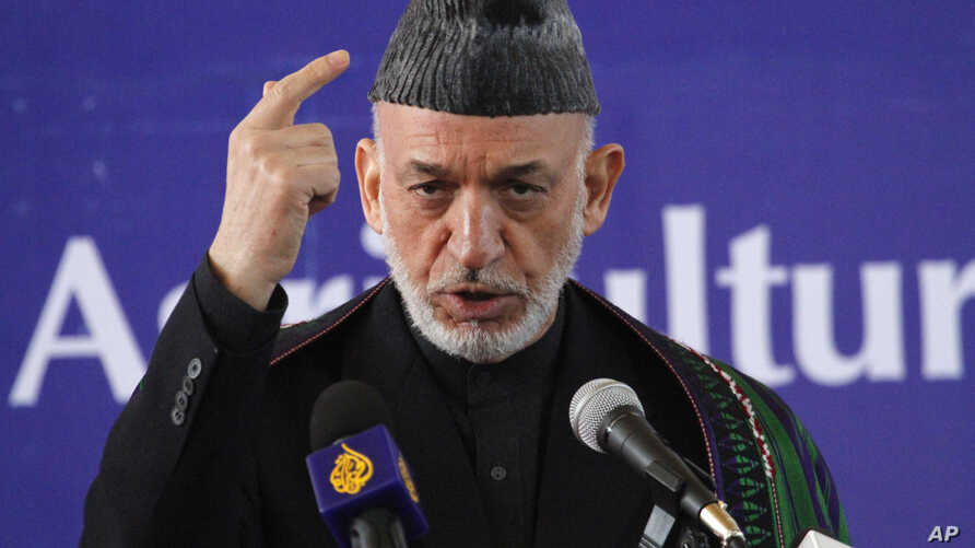 Afghan President Hamid Karzai speaks at the inauguration ceremony of the Afghan National Agriculture Science and Technology University, Saturday, Feb. 15, 2014