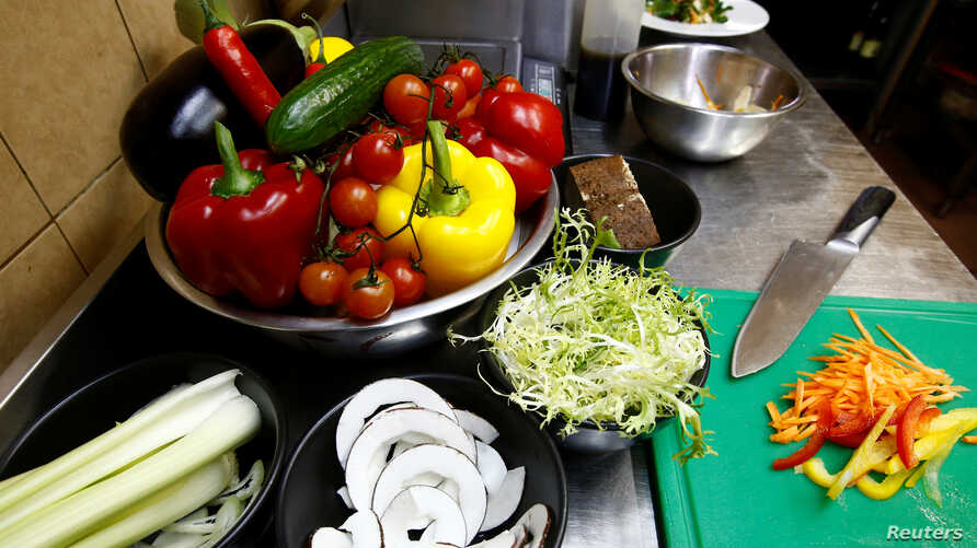 FILE - Vegetables are seen in vegetarian restaurant in Minsk, Belarus, Feb. 1, 2018. Researchers found that clever marketing using appealing descriptions of food can help boost sales of plant-based dishes.