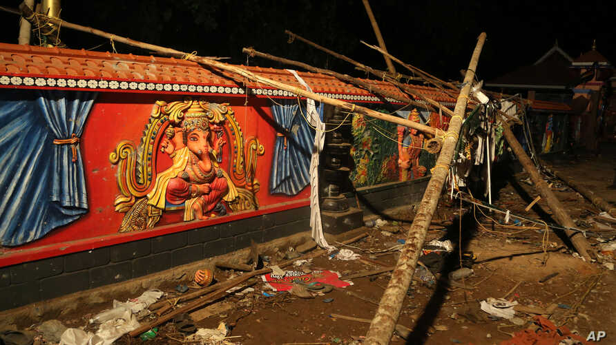 Debris lies against a wall at the Puttingal temple in Kerala state, India. About 100 died when a fire broke out at the temple during a fireworks display April 10, 2016.