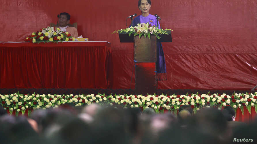 Burma's pro-democracy leader Aung San Suu Kyi delivers her speech at the National League for Democracy party's congress March 10, 2013.