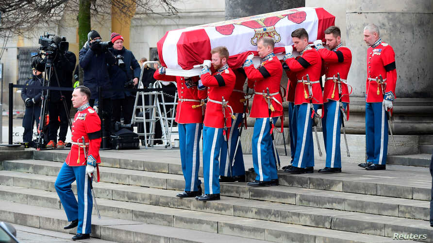 The coffin leaves the church after the funeral of Prince Henrik which took place at Christiansborg Palace Chapel in Copenhagen, Denmark, Feb. 20, 2018.