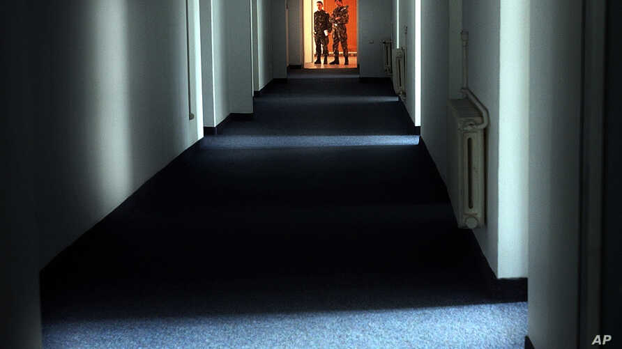 FILE - Romanian military staff stand at the end of a corridor on the Mihail Kogalniceanu airbase, near the Black Sea port of Constanta, Romania, a Soviet-era facility which became a key focus of a European investigation into allegations the CIA opera