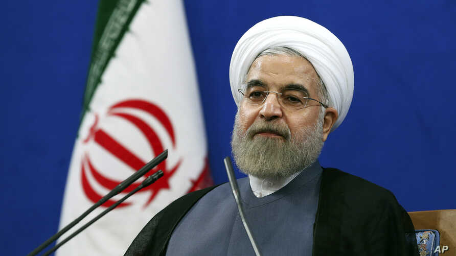 Iran's President Hassan Rouhani, speaking at a Tehran news conference on the second anniversary of his election, vowed that his nation wouldn't allow state secrets to be jeopardized under the cover of international inspections. June 13, 2015.
