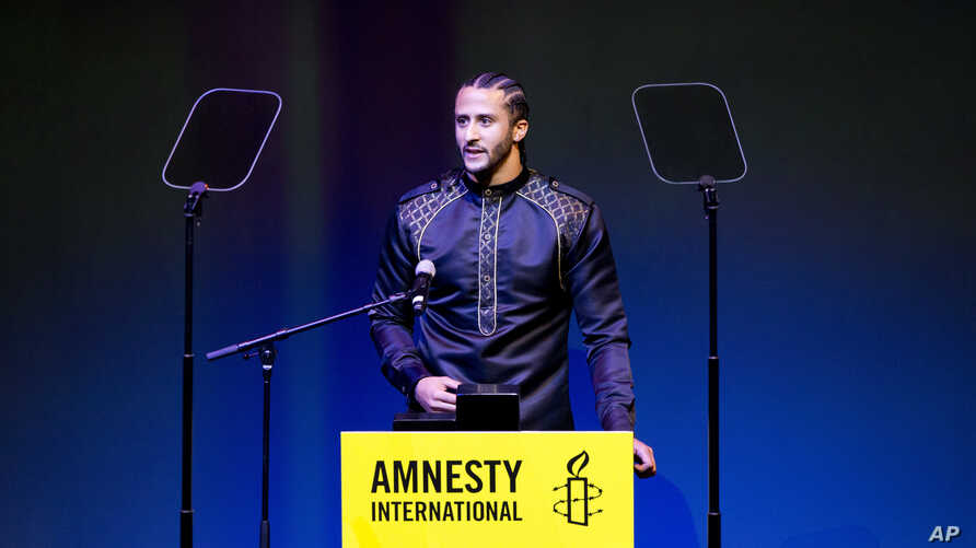 Former NFL quarterback and social justice activist Colin Kaepernick speeches after receiving the Amnesty International Ambassador of Conscience Award for 2018 in Amsterdam, Saturday April 21, 2018. Kaepernick became a controversial figure when refusi
