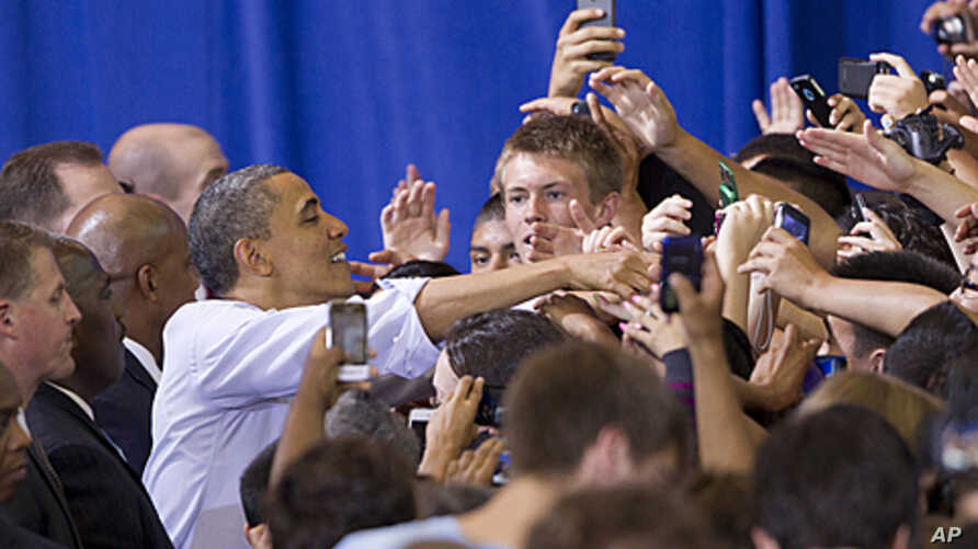 President Barack Obama reaches out to students and parents at Washington-Lee High School in Arlington, Virginia, May 4, 2012.