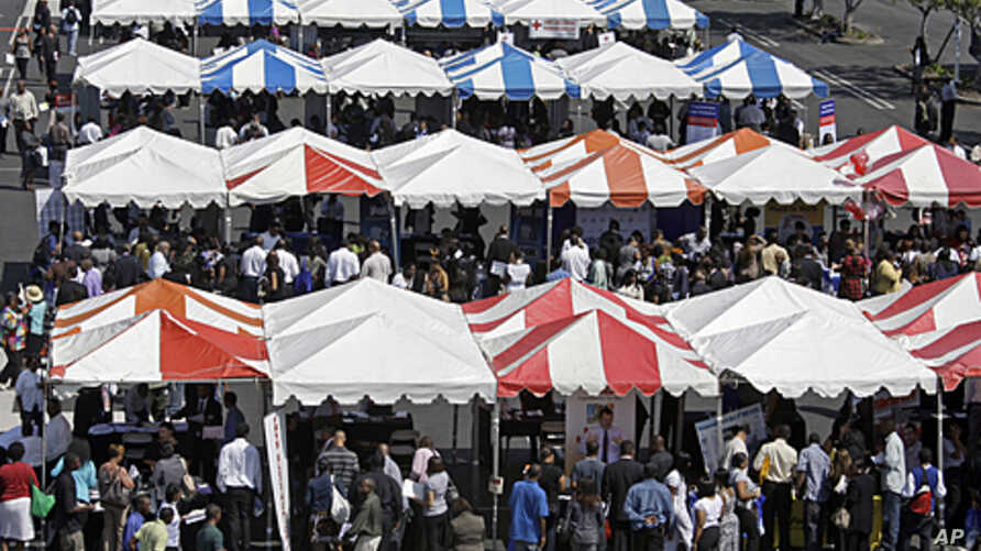 """Dozens of employer booths are seen at a job fair called the """"For The People Jobs Initiative,"""" where job seekers met employers, job counselors, skills trainers and others, at Crenshaw Christian Center in South Los Angeles, August 31, 2011."""